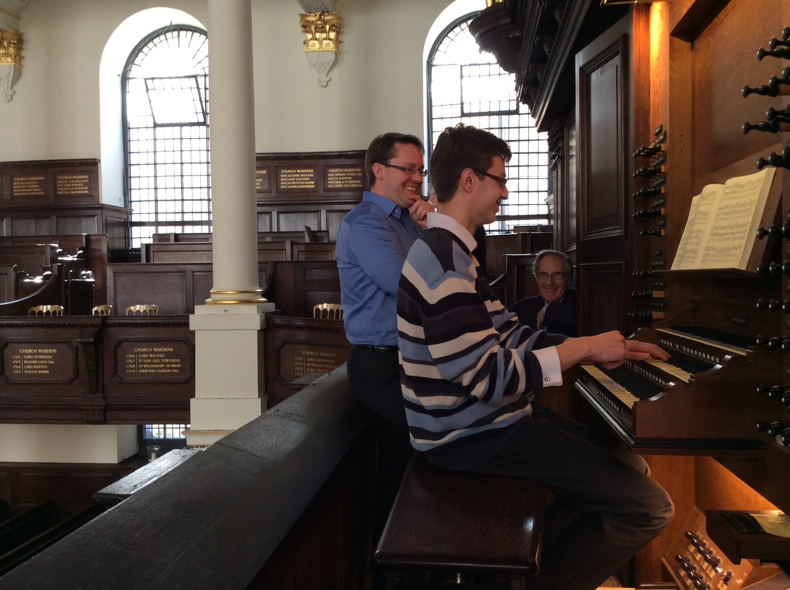 Image: Ashley Wagner at the organ with Robin Walker and Peter St John Stokes